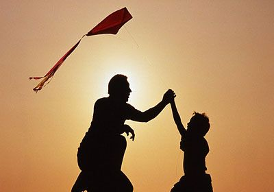 man with son and kite